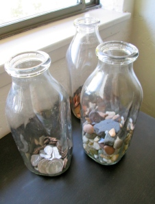 Vintage Milk Bottles. I fill mine with coins and rocks.